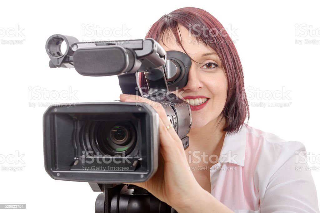 pretty young woman with a professional camera stock photo