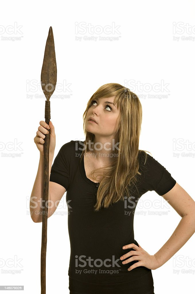 Pretty young woman with a spear royalty-free stock photo