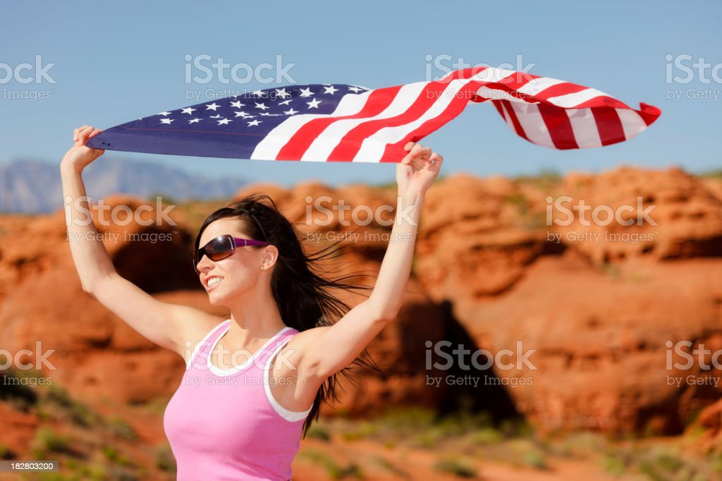Pretty Young Woman with American Flag royalty-free stock photo