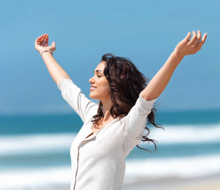 Pretty Young Woman With Arms Raised Stock Photo - Download Image Now