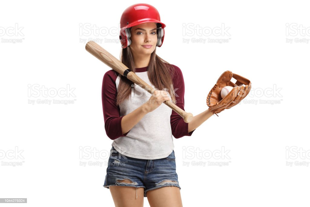 Pretty young woman with baseball equipment isolated on white...