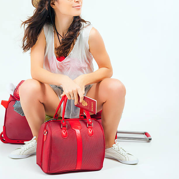 Pretty young woman with big luggage waiting your flight plane picture id517541966?b=1&k=6&m=517541966&s=612x612&w=0&h=e4dmvhyjlgmofnbxogrhljkratouqtpybhf31fgbm9k=