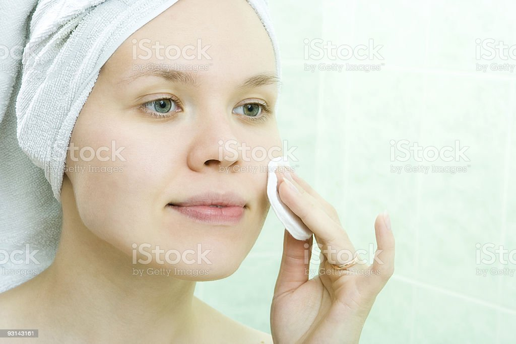 Pretty young woman with cleansing pad stock photo