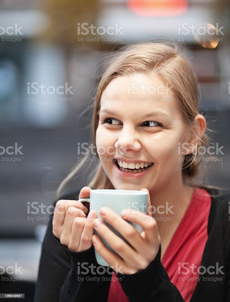 Pretty young woman with cup of chocomilk stock photo