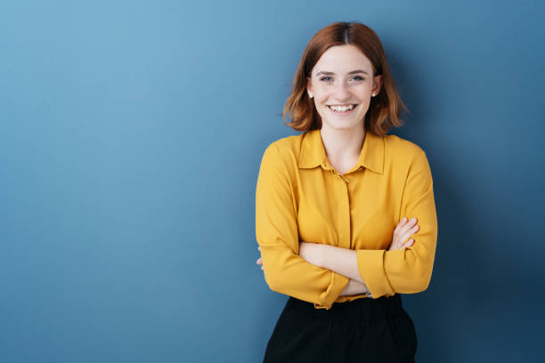 Pretty young woman with folded arms stock photo