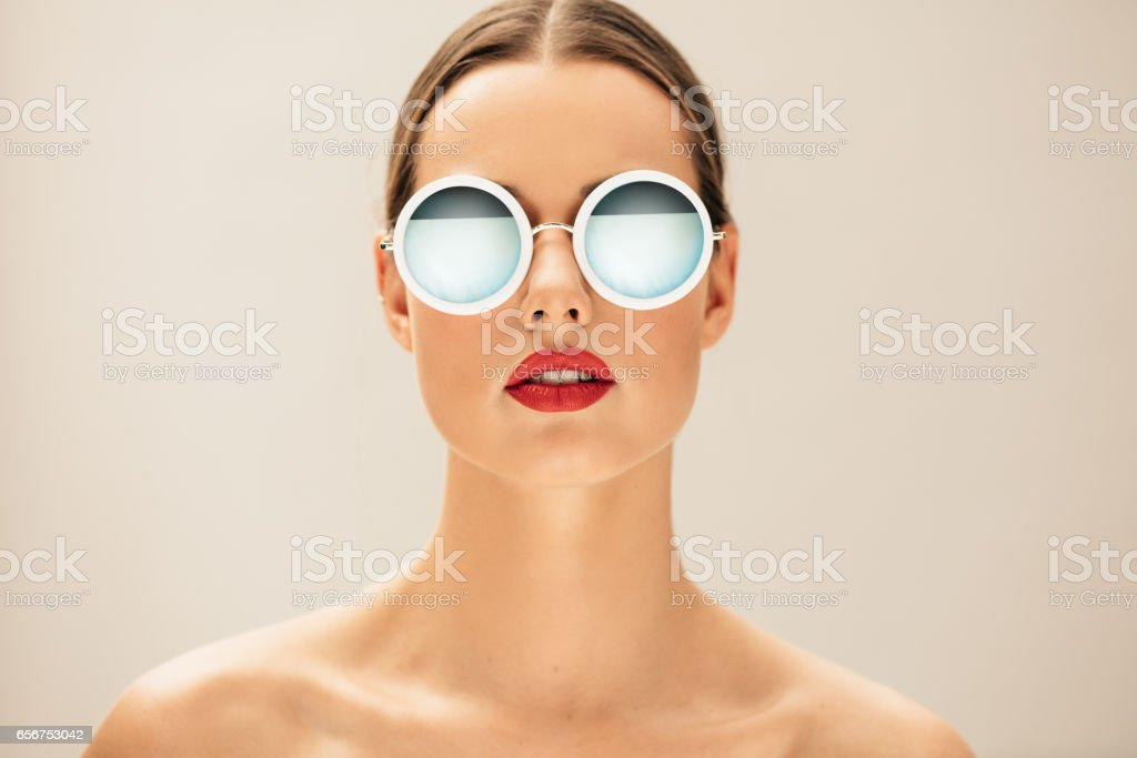 Pretty young woman with glasses stock photo