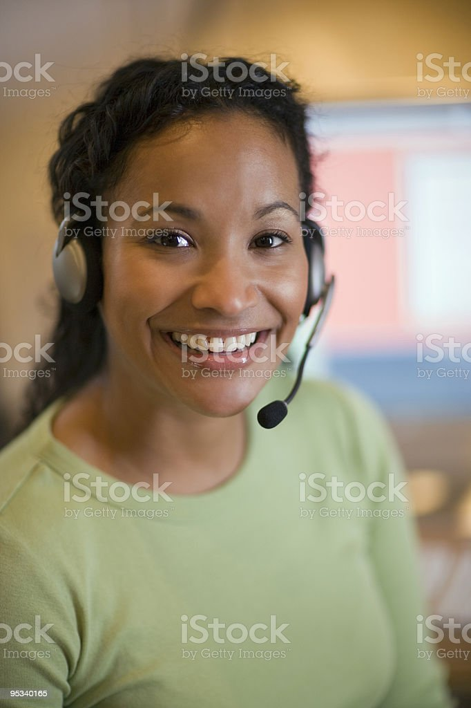 Pretty young woman with headset royalty-free stock photo