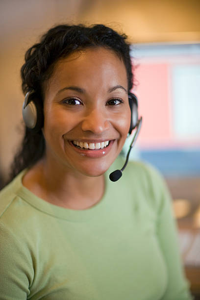 Pretty young woman with headset stock photo