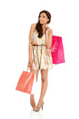 istock Pretty young woman with shopping bags looking away 454136067