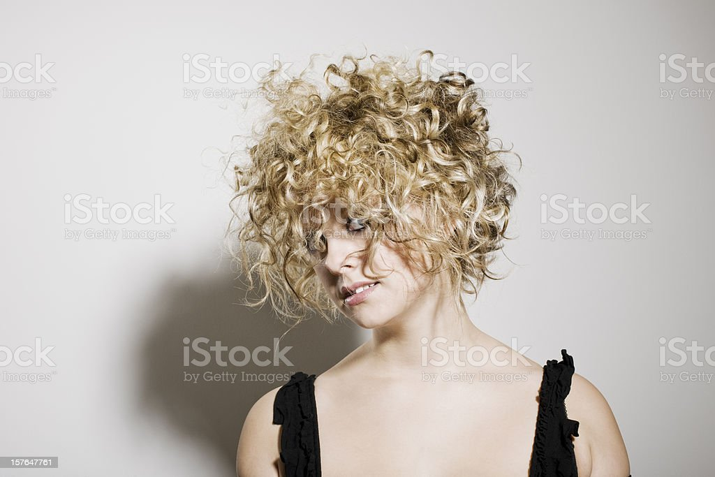 Pretty young woman with wild crazy blonde hair stock photo