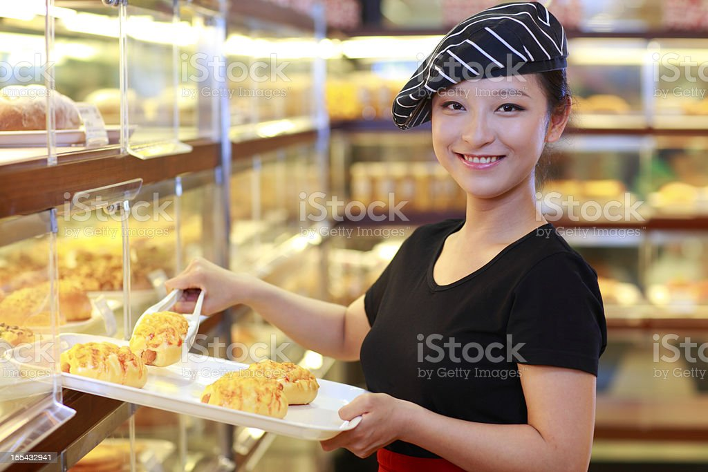 pretty young woman working in the bakery royalty-free stock photo