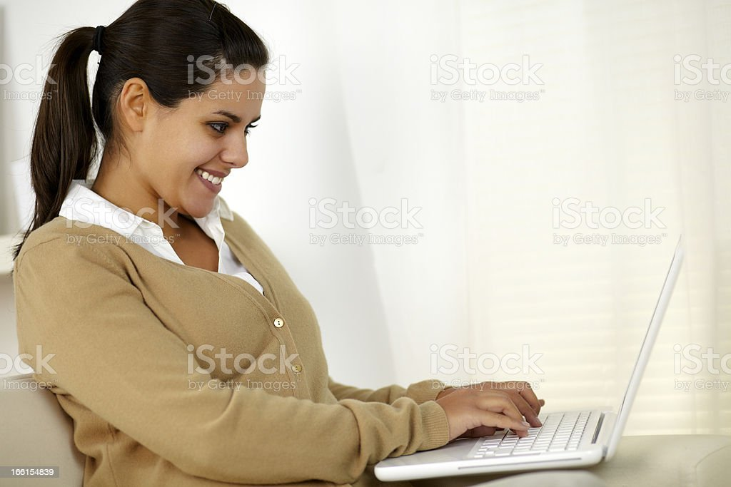 Pretty young woman working on laptop computer royalty-free stock photo