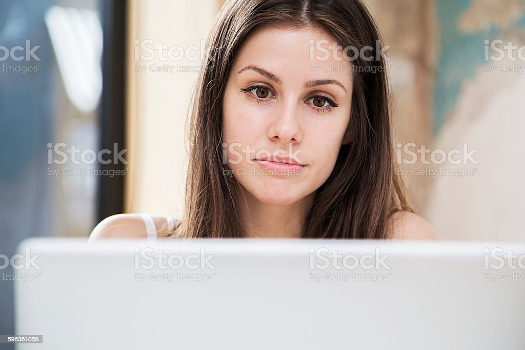Pretty young woman working on laptop in the office royalty-free stock photo