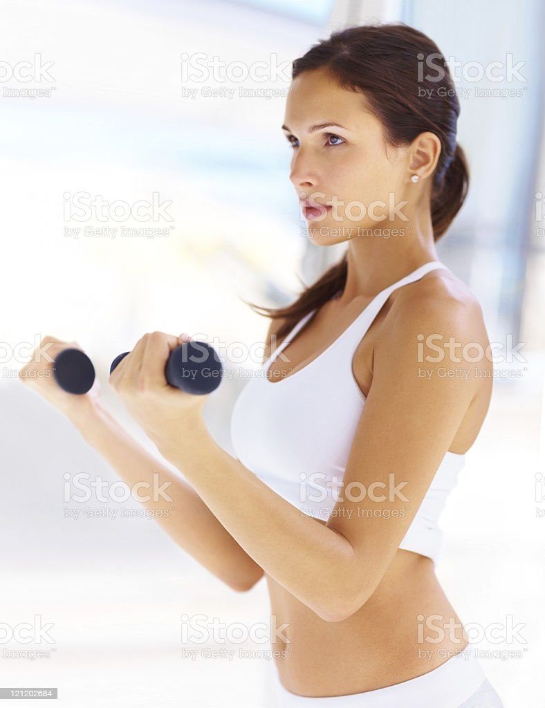 Pretty young woman working out with free weights royalty-free stock photo