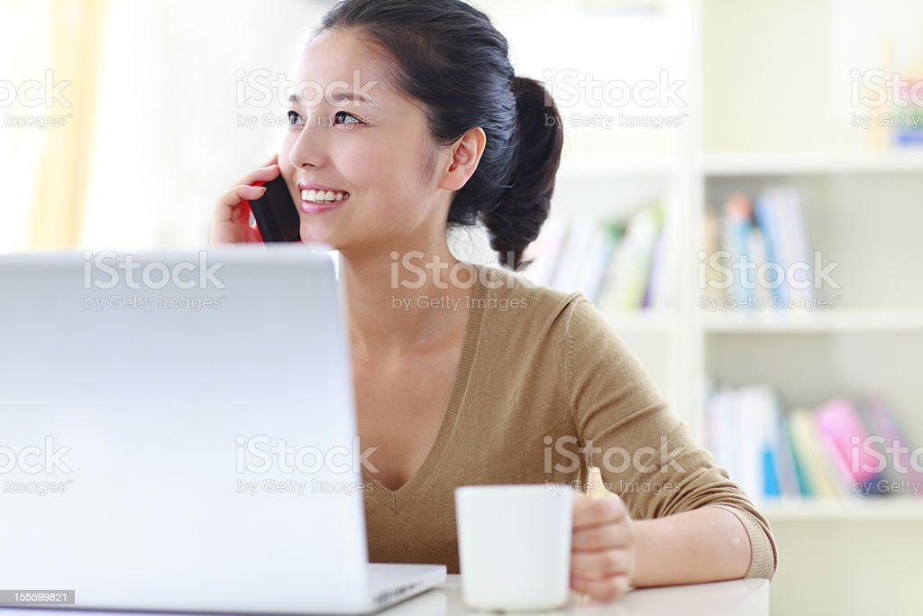 pretty young woman working with laptop indoor royalty-free stock photo