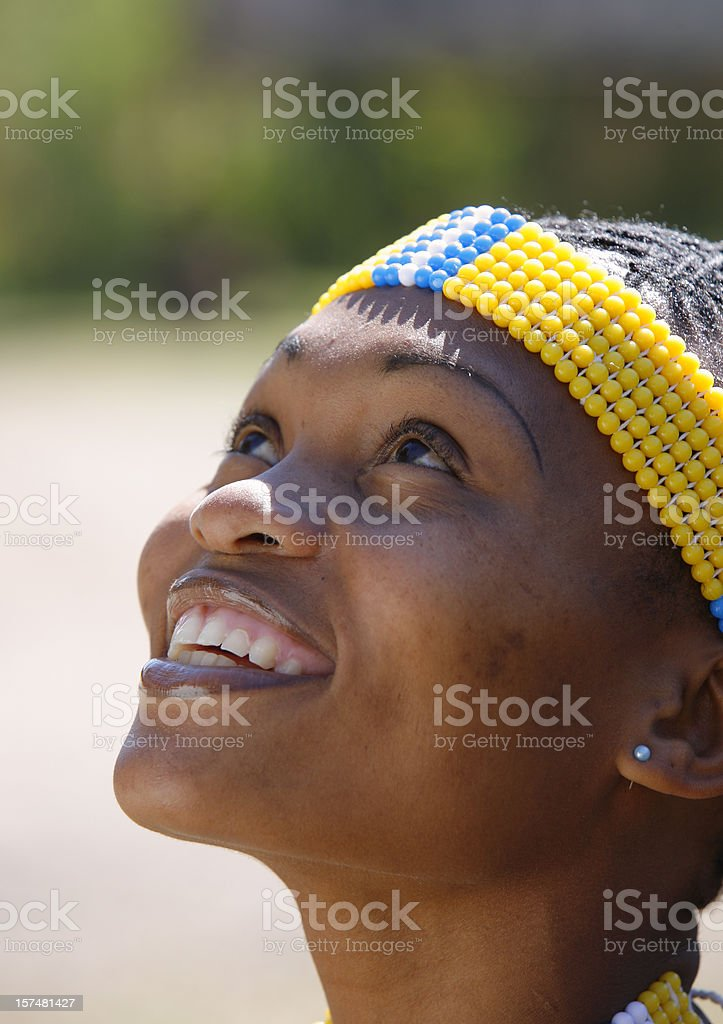 Pretty Zulu woman looking up royalty-free stock photo
