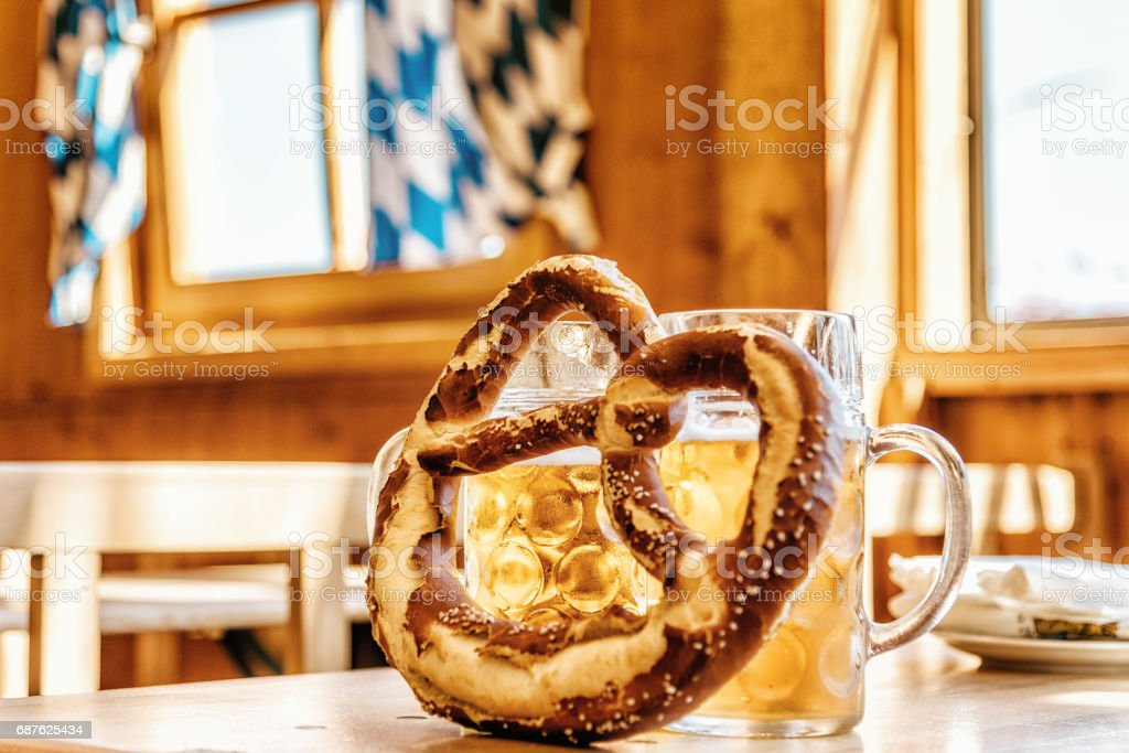 pretzel and beer glasses on Table in Oktoberfest pavilion stock photo