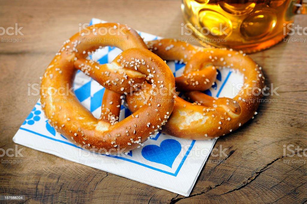 Pretzel and beer on bavarian napkin royalty-free stock photo