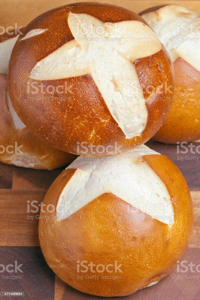 Pretzel buns, freshly baked stock photo