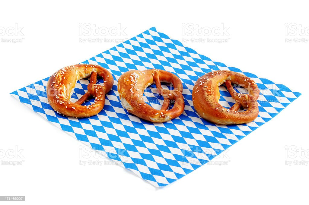 Pretzel on blue white bavarian napkin typical Oktoberfest food royalty-free stock photo