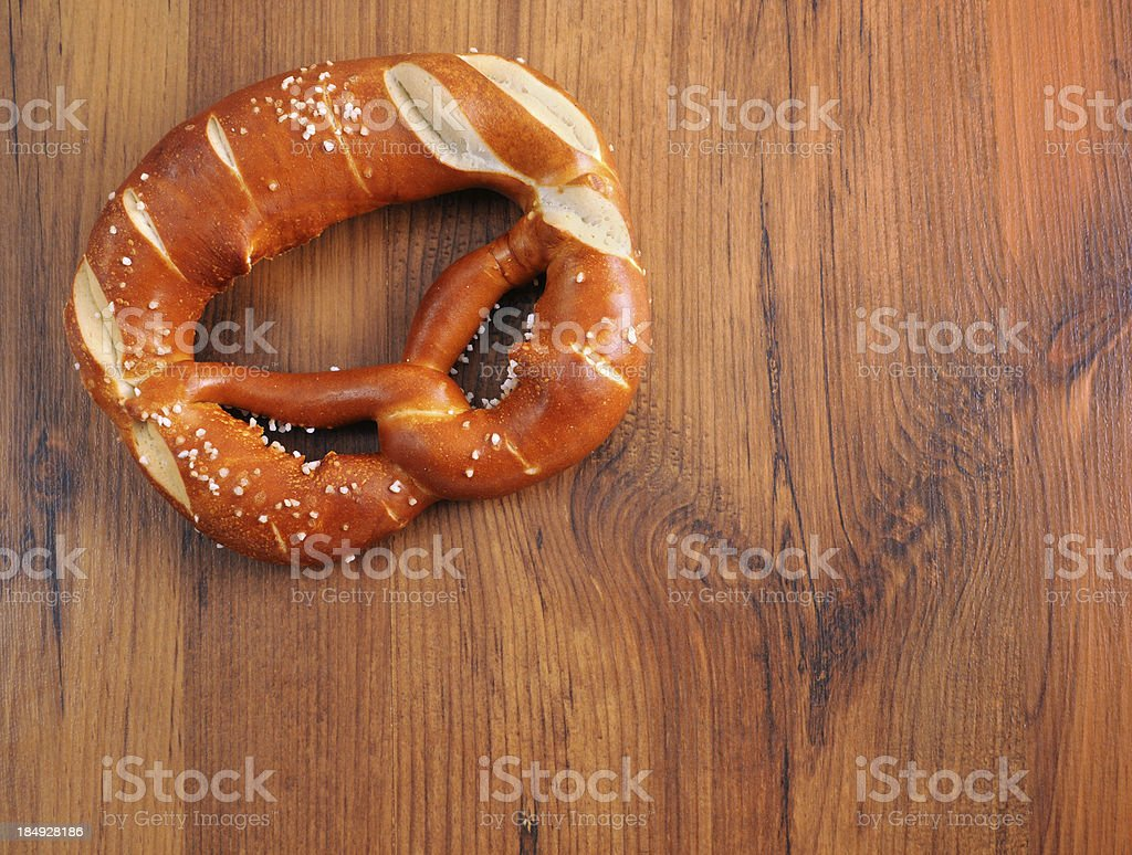 Pretzel on wooden table copyspace typical Oktoberfest food royalty-free stock photo