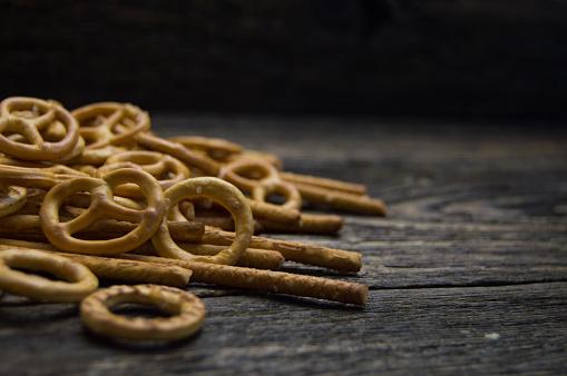pretzel sticks on wooden table