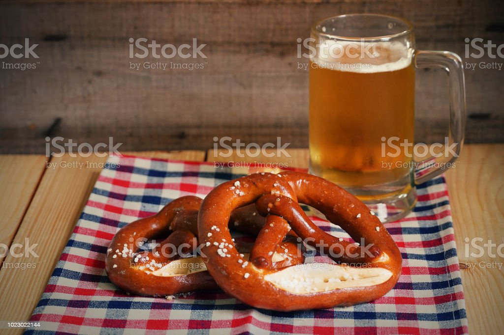 Pretzel with beer on wood table,Oktober background. stock photo