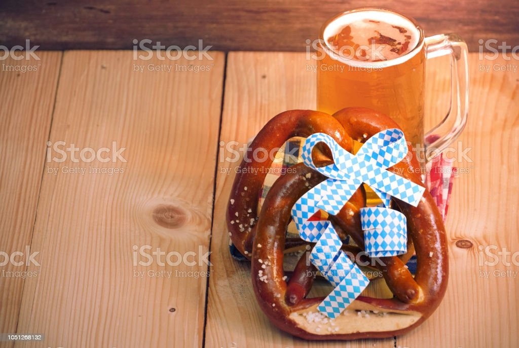 Pretzel with glass of beer on wood table for oktoberfest,have space for copy. stock photo