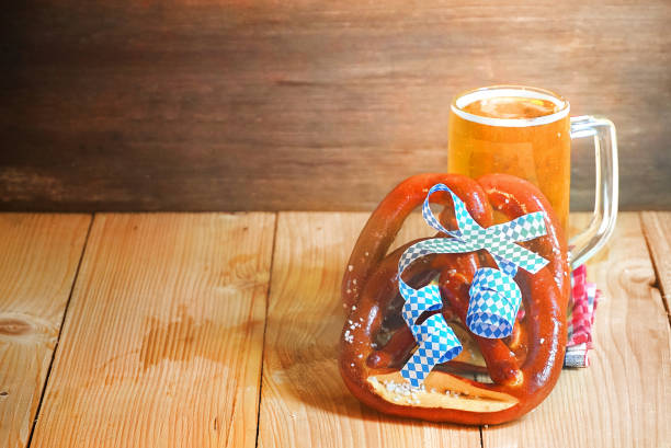 Pretzel with glass of beer on wood table,have space for copy. stock photo