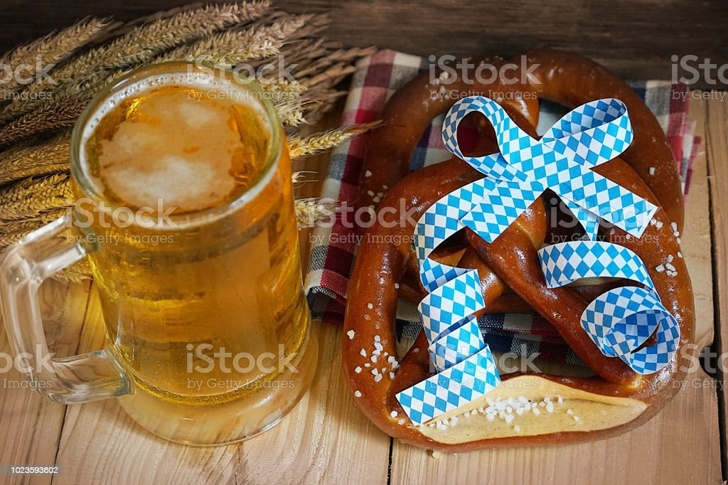 Pretzel with glass of beer on wood table,Oktober background. stock photo