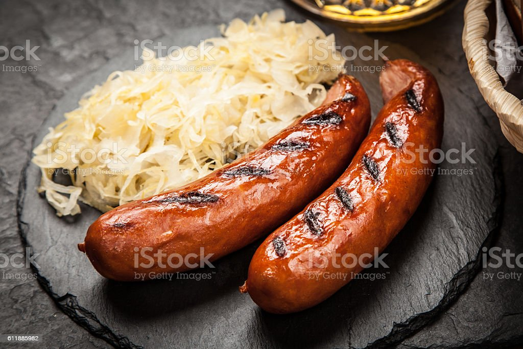 Pretzels, bratwurst and sauerkraut bildbanksfoto