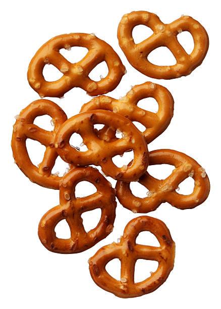 pretzels close up on white background - 椒鹽蝴蝶圈 個照片及圖片檔
