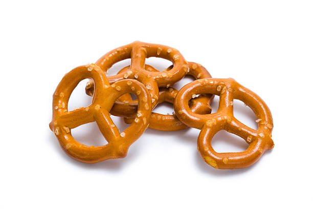 Pretzels in a pile isolated on white stock photo
