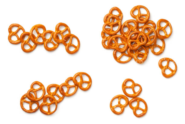 pretzels isolated on white background - twisted stock pictures, royalty-free photos & images