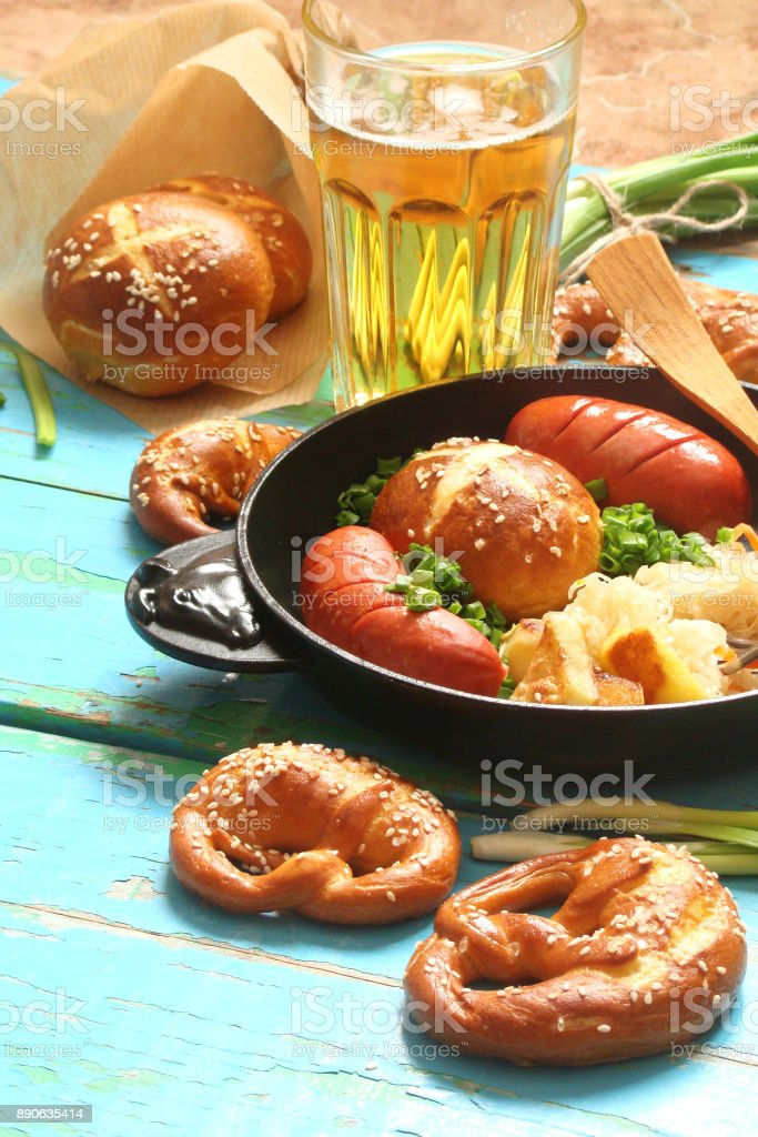 pretzels with sesame seeds and salt, fried cabbage, potatoes, shpikachki and beer stock photo