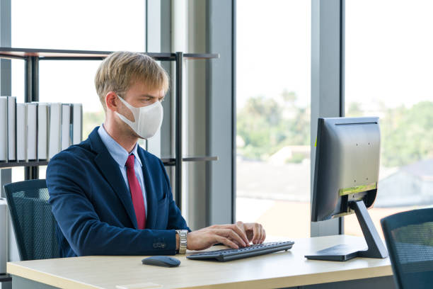 prevent the transmission of disease by wearing a surgical mask. - businessman covid mask foto e immagini stock