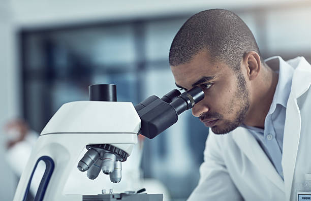 prevention is better than cure - microscope stock photos and pictures