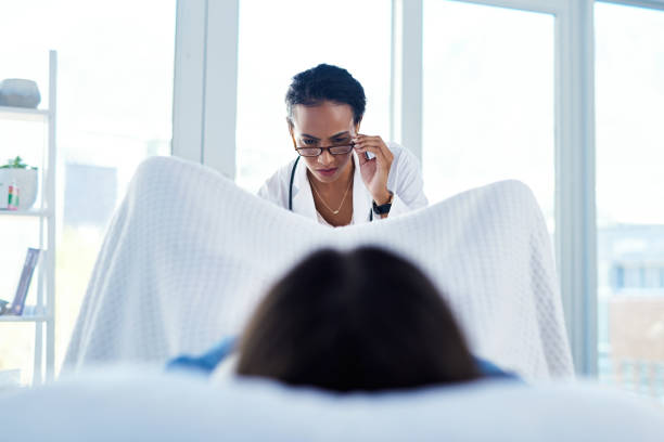 Prevention is better than cure...get screened Shot of a young woman having a consultation with a gynaecologist gynecological examination stock pictures, royalty-free photos & images