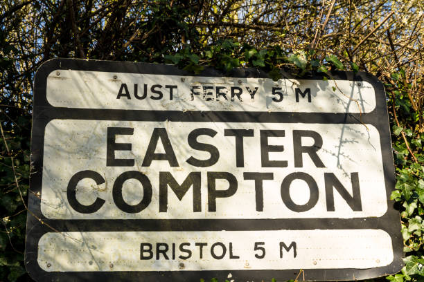 Pre-worboys old road sign for Easter Compton including Aust Ferr Sign for village of Easter Compton still shows distance to Aust Ferry which closed down in 1966 anachronistic stock pictures, royalty-free photos & images