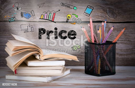 istock Price, Business Concept. Stack of books and pencils on the woode 820321626