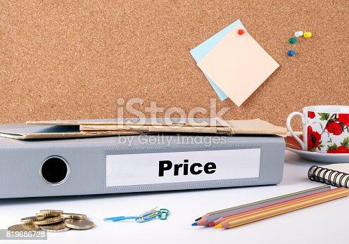 istock Price. Folder on office desk. Money, Coffee Mug and colored penc 819686728