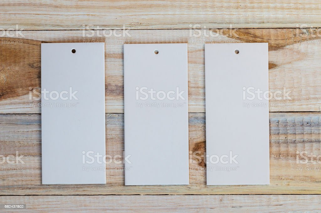 price tag or paper label on wood background royalty-free stock photo