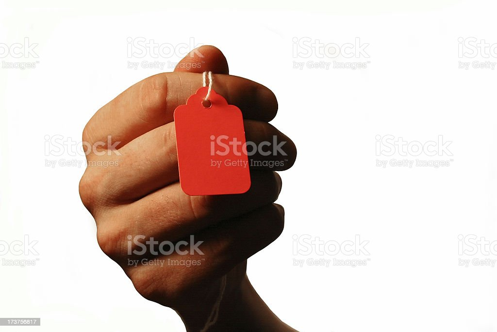 Priceless: Hand Holding Blank Shopping Price Tag royalty-free stock photo