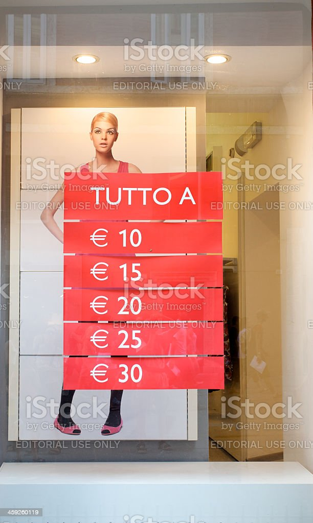 Prices exposed at showcase during a sale period royalty-free stock photo