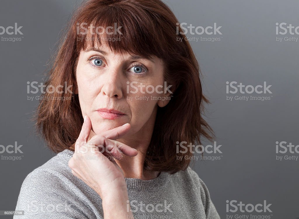pride and arrogance for unhappy sad 50s woman stock photo