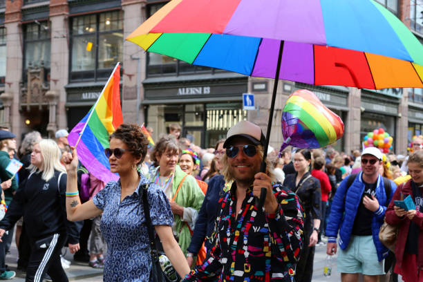 Pride Parade of Helsinki 2019: Rainbow Colored Flags and Accessories stock photo