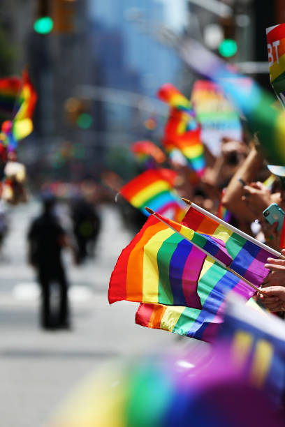 Pride parade Gay rainbow flags are seen during New York Pride Parade gay pride parade stock pictures, royalty-free photos & images