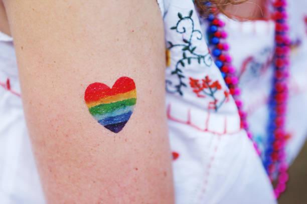 pride parade - pailletten shirt stock-fotos und bilder
