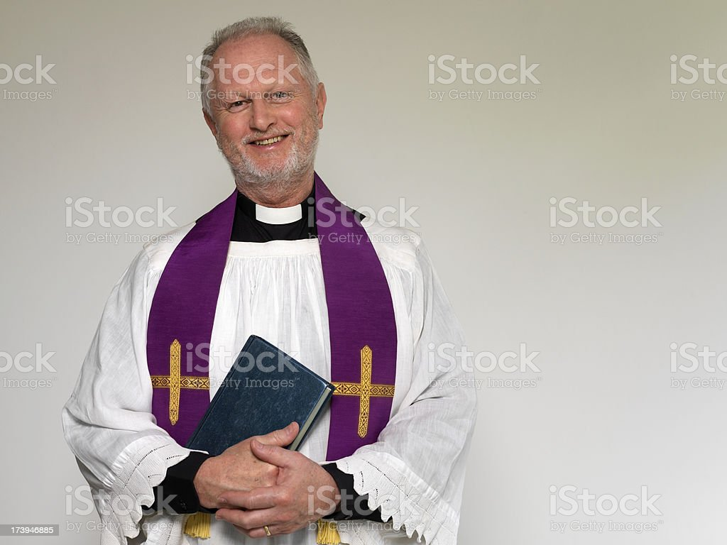 Priest and Bible stock photo