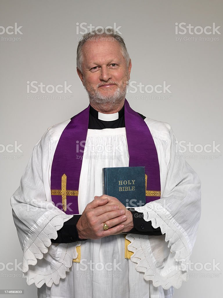 Priest and Bible royalty-free stock photo